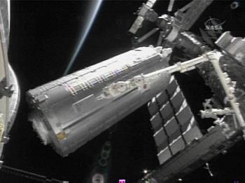 The Japanese Kibo Module is moved from the US space shuttle Discovery cargo bay (AFP/NASA)