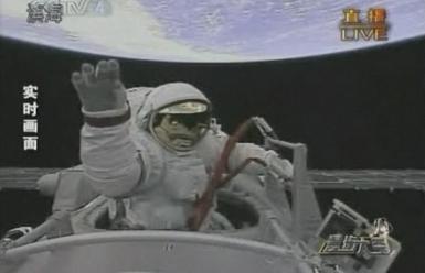 Zhai Zhigang exits the Shenzhou-7 capsule with Earth overhead (Xinhua/BBC)