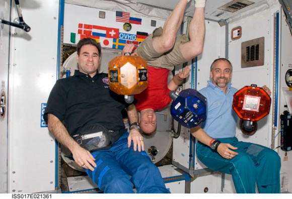 Astronauts Greg Chamitoff, Mike Fincke and spaceflight participant Richard Garriott posed with SPHERES.  Credit: NASA
