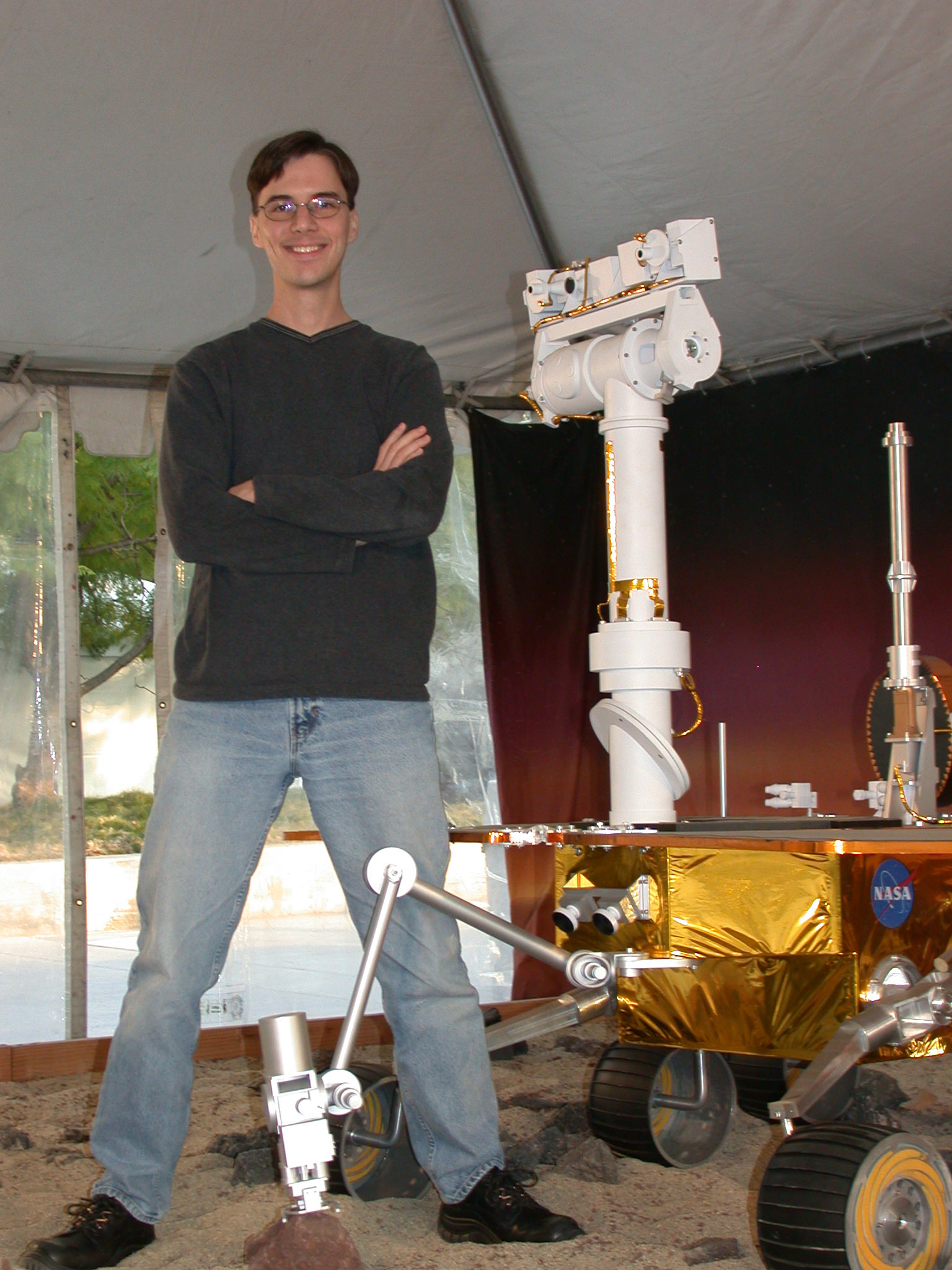 Rover Driver Scott Maxwell with a model of MER.  Photo courtesy Scott Maxwell
