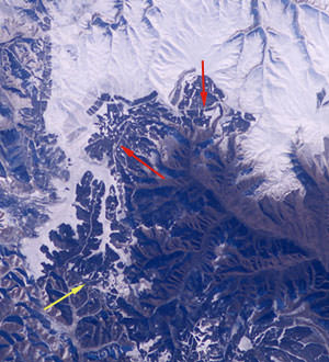 This photo of central Inner Mongolia, about 200 miles north of Beijing, was taken on Nov. 24, 2004, from the International Space Station. The yellow arrow points to an estimated location of 42.5N 117.4E where the wall is visible. The red arrows point to other visible sections of the wall. Credit: NASA.