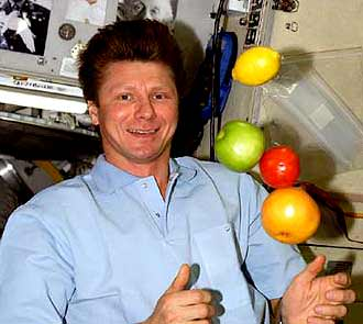 Padalka on the ISS:  Sharing food is good in space.  Credit: NASA