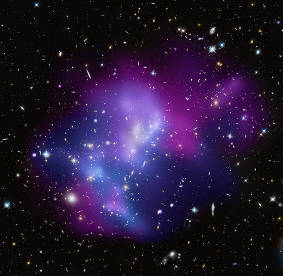 Composite image of MACSJ0717. Credit: X-ray (NASA/CXC/IfA/C. Ma et al.); Optical (NASA/STScI/IfA/C. Ma et al.)
