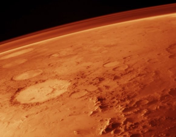 Mars' thin atmosphere, visible on the horizon, is too weak to retain heat. Credit: NASA