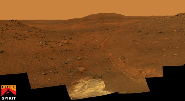 "This full-circle view from the panoramic camera (Pancam) on NASA's Mars Exploration Rover Spirit shows the terrain surrounding the location called ""Troy,"" where Spirit became embedded in soft soil during the spring of 2009.  Credit: NASA/JPL"