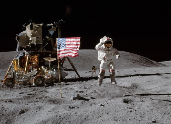 John W. Young on the Moon during Apollo 16 mission. Charles M. Duke Jr. took this picture. The LM Orion is on the left. April 21, 1972. Credit: NASA
