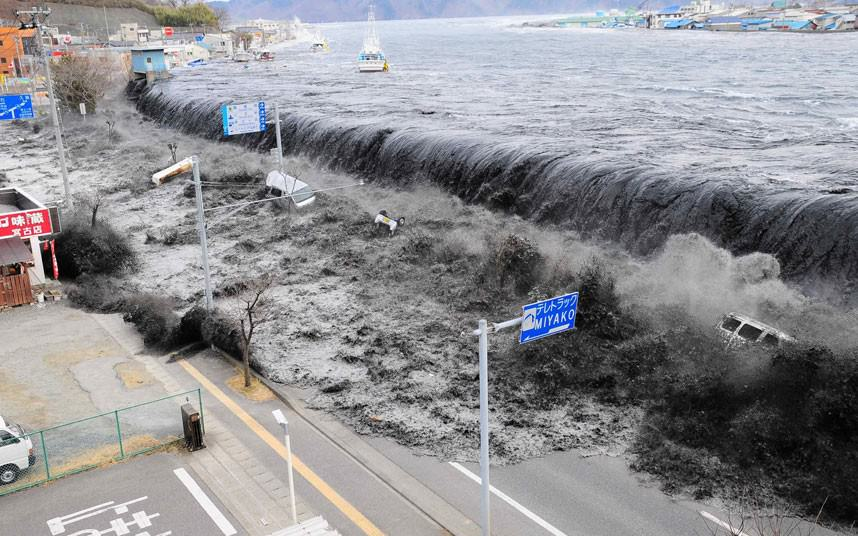 11 March 2011: The wave from a tsunami crashes over a street in Miyako City, Japan Credit: REUTERS/Mainichi Shimbun