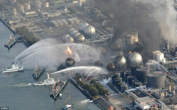 Ships try to extinguish a blaze at oil refinery tanks in Ichihara, Chiba Prefecture, which has been burning since Friday's earthquake and tsunami Read more: http://www.dailymail.co.uk/news/article-1366395/Japan-tsunami-earthquake-Rescuers-pick-way-apocalypse-wasteland.html#ixzz3dvVfz0hr Follow us: @MailOnline on Twitter | DailyMail on Facebook Credit: EPA