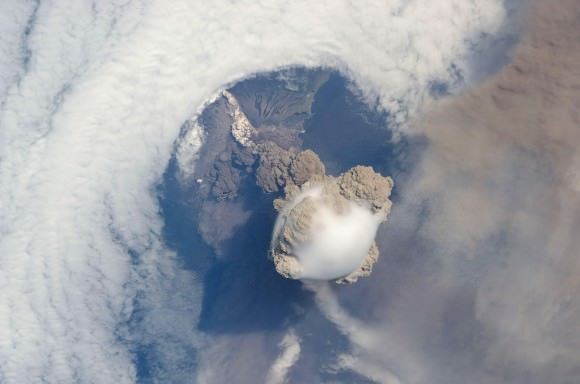 Sarychev volcano, (located in Russia's Kuril Islands, northeast of Japan) in an early stage of eruption on June 12, 2009. Credit: NASA