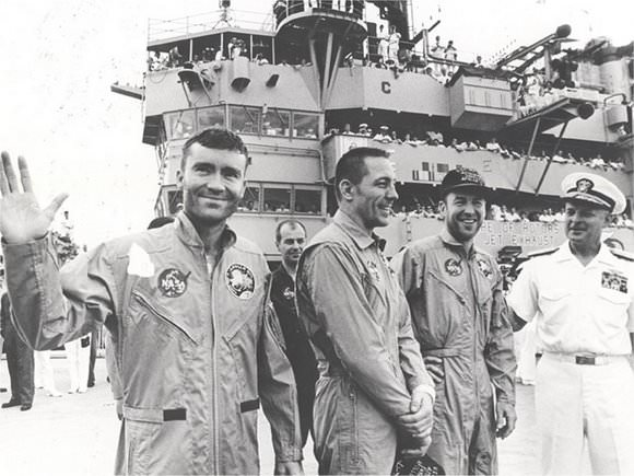 The crew of Apollo 13 after they splashed down safely.  Credit: NASA