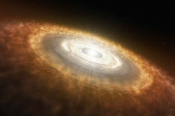 Young stars have a disk of gas and dust around them called a protoplanetary disk. Out of this disk planets are formed, and the presence of water ice in the disc affects where different types of planets form. Credit: NASA/JPL-Caltech