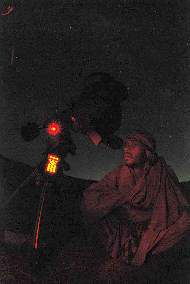 A local famer from Afghanistan looks at the night sky through a telescope.  Credit: Saeid Aghaei.