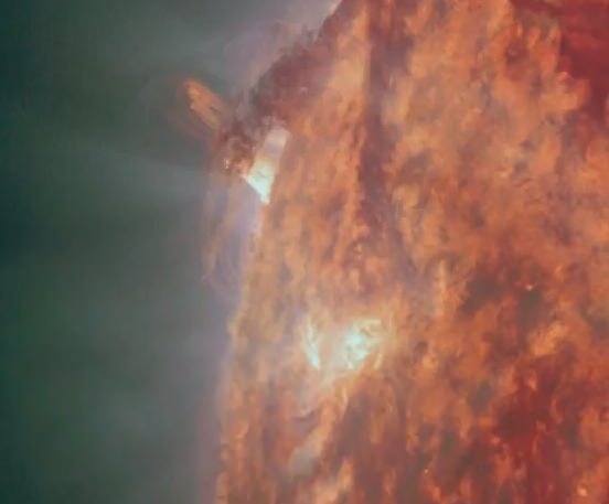 A filament partially blocks SDO's view of erupting plasma on Dec. 9. (NASA/SDO)
