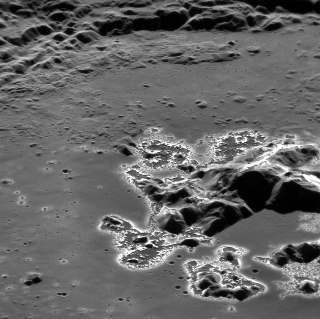 "MESSENGER captures image of curious ""hollows"" around a crater peak"