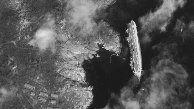 Capsized Costa Concordia Cruise Ship, Giglio, Italy- January 17, 2012; The Costa Concordia luxury cruise ship ran aground in the Tuscan waters off of Giglio,Italy on Friday, January, 2012. Credit: DIGITALGLOBE   See the Full Image below