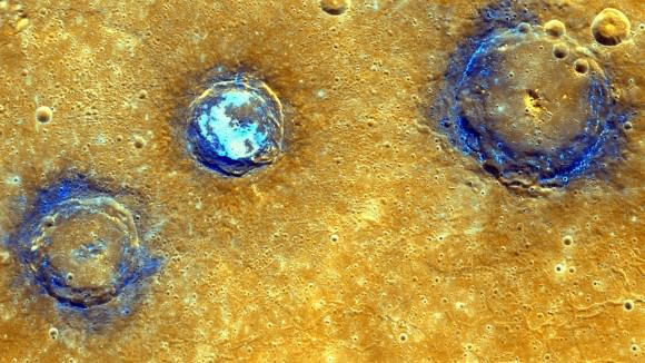 Enhanced-color image of Munch, Sander and Poe craters amid volcanic plains (orange) near Caloris Basin NASA/Johns Hopkins University Applied Physics Laboratory/Carnegie Institution of Washington