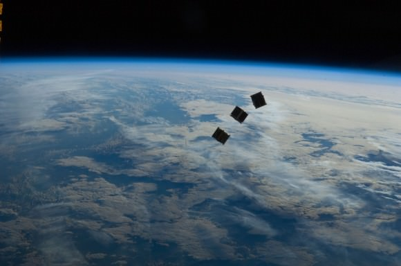 Three small CubeSats are deployed from the International Space Station on October 4, 2012. Credit: NASA