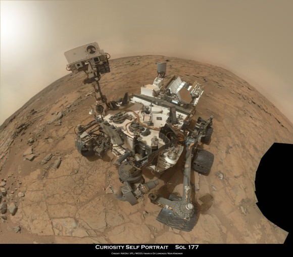 "Rover self portrait MAHLI mosaic taken this week has Curiosity sitting on the flat rocks of the ""John Klein"" drilling target area within the Yellowknife Bay depression. Note gradual rise behind rover. Credit: NASA/JPL-Caltech/MSSS/Marco Di Lorenzo/www.KenKremer.com."