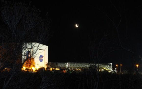 Antares rocket begins 1st ever rollout from processing hanger to NASA Wallops launch pad - beneath the Moon on 6 April 2013.  Credit: Ken Kremer (kenkremer.com)