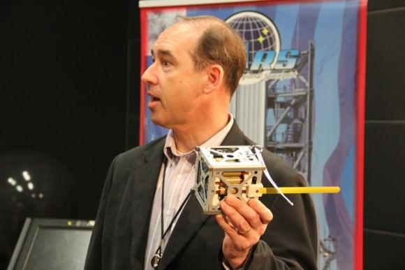 Andrew Petro, NASA Small Satellite Program executive, holds NASA Smartphone Phonesat replica launched on Antares test flight on April 21, 2013. Credit: Ken Kremer (kenkremer.com)