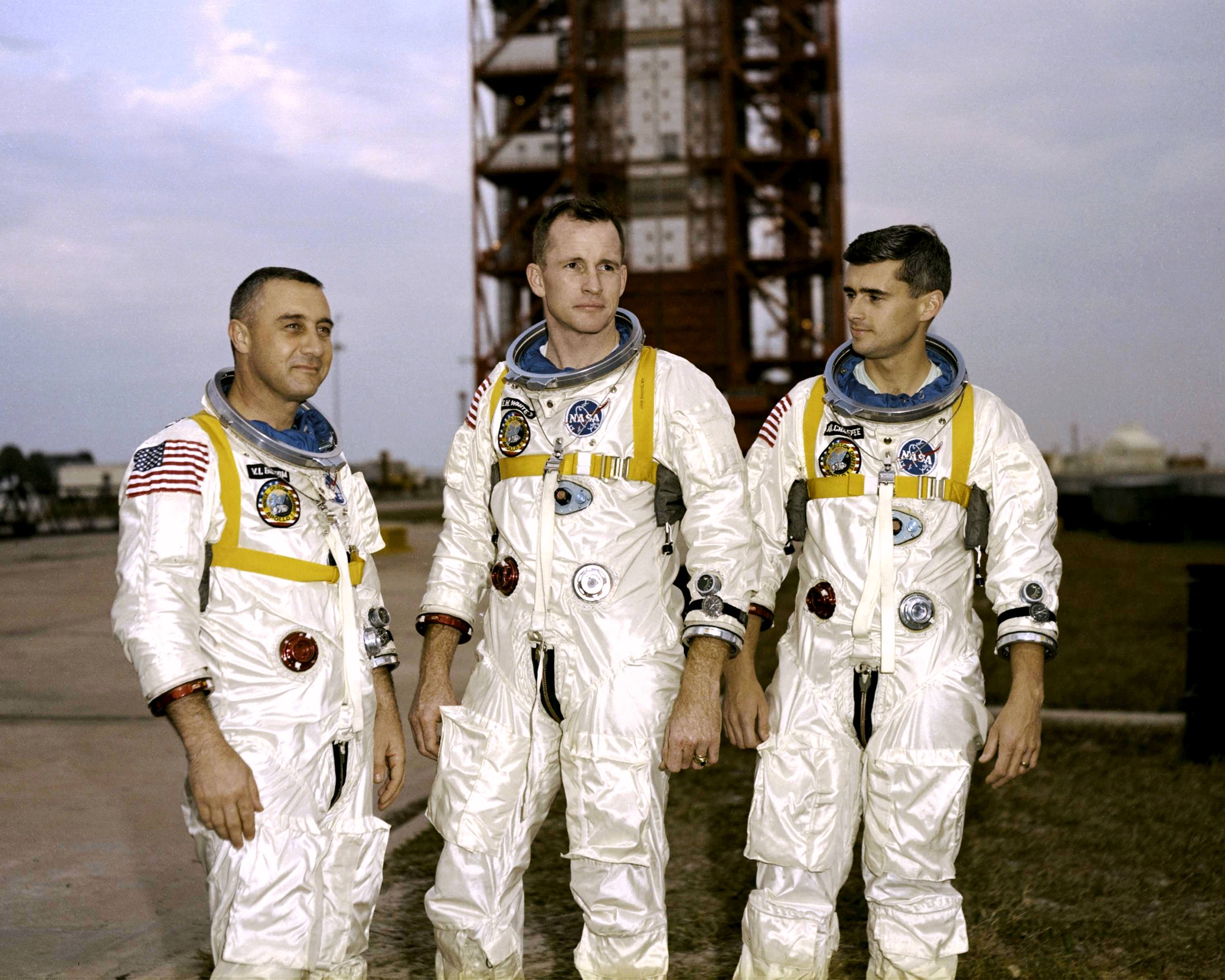 "Apollo 1 astronauts (from left) Virgil ""Gus"" Grissom, Edward White and Roger Chaffee stand near Cape Kennedy's Launch Pad 34 during training. Credit: NASA"