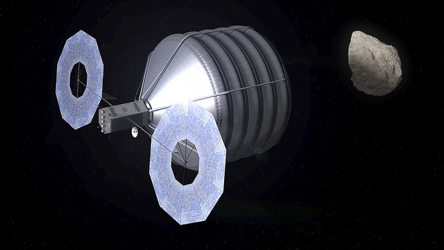 Concept of asteroid capture in progress. Credit: NASA.