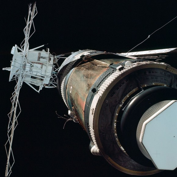 View of crippled Skylab complex during 'fly around' by the first crew shows missing  micrometeoroid shield and stuck solar panel which luckily was not ripped off during launch. Credit: NASA
