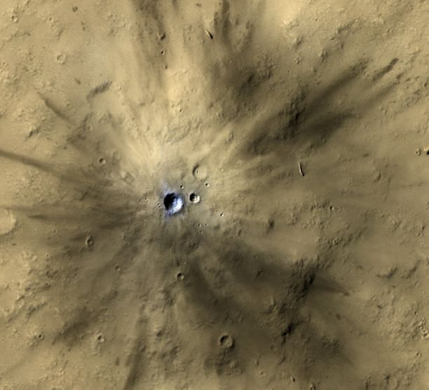 Mars is covered in craters, and many of them are obvious, and don't need AI to find them. This is one of many fresh impact craters spotted by the UA-led HiRISE camera, orbiting the Red Planet on board NASA's Mars Reconnaissance Orbiter since 2006. (Photo: NASA/JPL-Caltech/MSSS/UA).