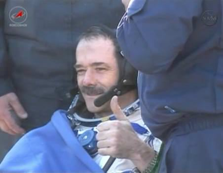 Canadian astronaut Chris Hadfield gives a thumbs up after landing safely in Kazahkstan. Via NASA TV.