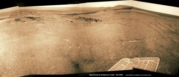 Wide angle view of Endeavour Crater showing Solander Point and Cape Tribulation in this photo mosaic captured by navcam camera on Sol 3335, June 11, 2013.  Opportunity will scale Solander after arriving in August 2013 in search of chemical ingredients to sustain Martian microbes.  Credit: NASA/JPL/Cornell/Marco Di Lorenzo/Ken Kremer (kenkremer.com)