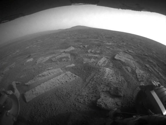 "This view from July 2, 2013 (Sol 3355) shows the terrain that NASA's Mars Exploration Rover Opportunity is crossing  in a flat area called ""Botany Bay"" on the way toward ""Solander Point,"" which is visible on the horizon. Credit: NASA/JPL-Caltech"