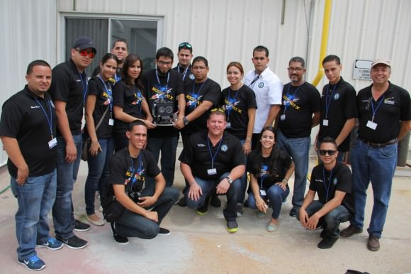 Rocket science university students from Puerto Rico pose for post flight photo op with their disengaged science experiment seeking to capture meteorite particles from space aboard Terrier-Improved Malemute sounding rocket that launched  on Aug. 13 at 6 a.m. from NASA Wallops Flight Facility, VA.  Credit: Ken Kremer/kenkremer.com