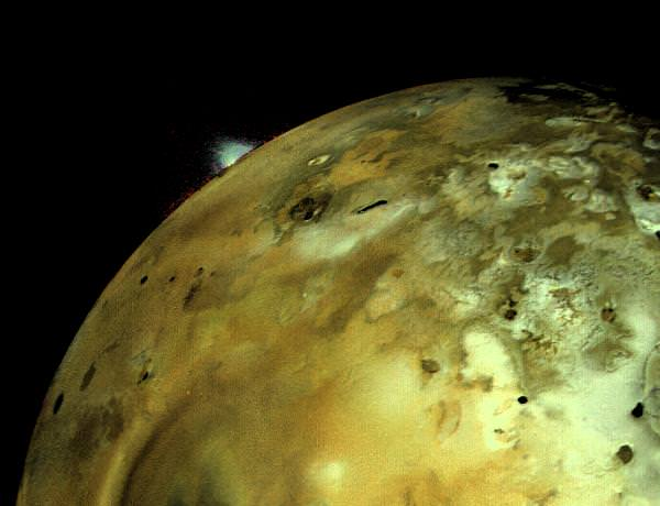 Voyager 1 acquired this image of Io on March 4, 1971. An enormous volcanic explosion can be seen silhouetted against dark space over Io's bright limb. Credit: NASA/JPL.