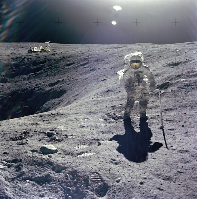 Astronaut Charles Duke collecting samples during Apollo 16. The original EMUs were rigid compared to the new xEMU design. Greater mobility will help astronauts carry out more detailed tasks. Credit: NASA.