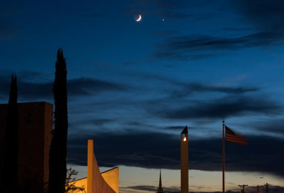 Moon and Venus conjunction over the Eternal Flame of the 9/11 Memorial located here in San Antonio, Texas. Credit and copyright: Adrian New.