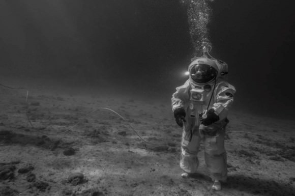 European Space Agency astronaut Jean-François Clervoy recreates the first moon landing mission underwater. Credit: Alexis Rosenfeld