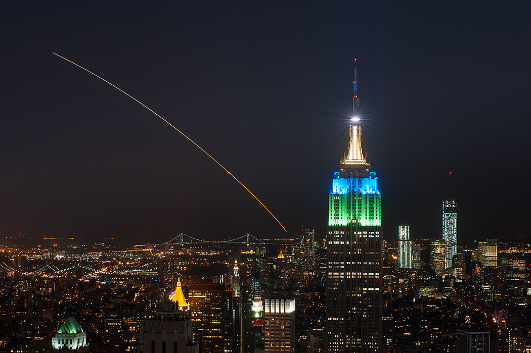This magnificent view of NASA's LADEE lunar orbiter launched on Friday night Sept 6, on the maiden flight of the Minotaur V rocket from Virginia was captured by space photographer Ben Cooper perched atop Rockefeller Center in New York City. Credit: Ben Cooper/Launchphotography.com