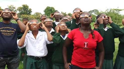 Students in Tanzania demonstrating proper eclipse viewing safety. (Credit: Astronomers Without Borders).