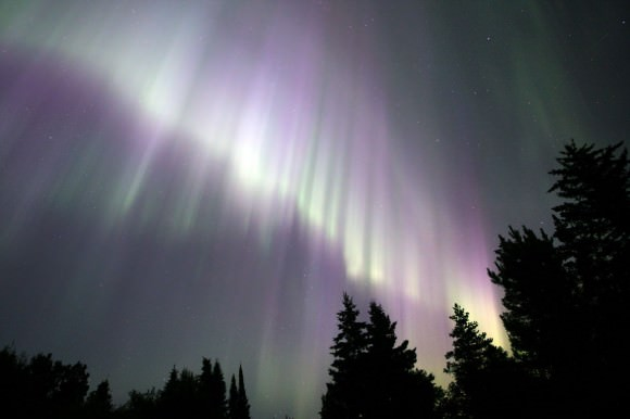 A massive wall of bright purple and green rays from July 20, 2012. Details: 16mm at f/2.8, ISO 800 and 20 second exposure. Credit: Bob King
