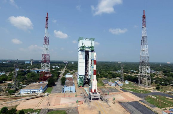Gorgeous view of the majestic Polar Satellite Launch Vehicle, PSLV C25 with its passenger, the Indian Space Research Organization's (ISRO's) Mars Orbiter Mission (MOM) spacecraft inside. The Mobile service tower is also seen in the background.  Credit: IRSO
