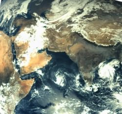 First ever image of Earth Taken by Mars Color Camera aboard India's Mars Orbiter Mission (MOM) spacecraft while orbiting Earth and before the Trans Mars Insertion firing on Dec. 1, 2013. Image is focused on the Indian subcontinent.  Credit: ISRO