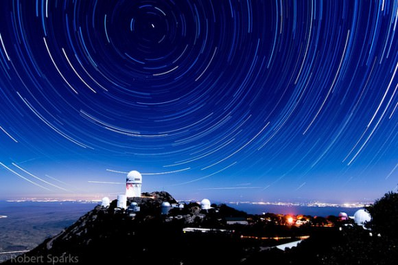 162 images combined to create star trails in this image taken of Kitt Peak in November 2013. Credit and copyright: Robert Sparks.