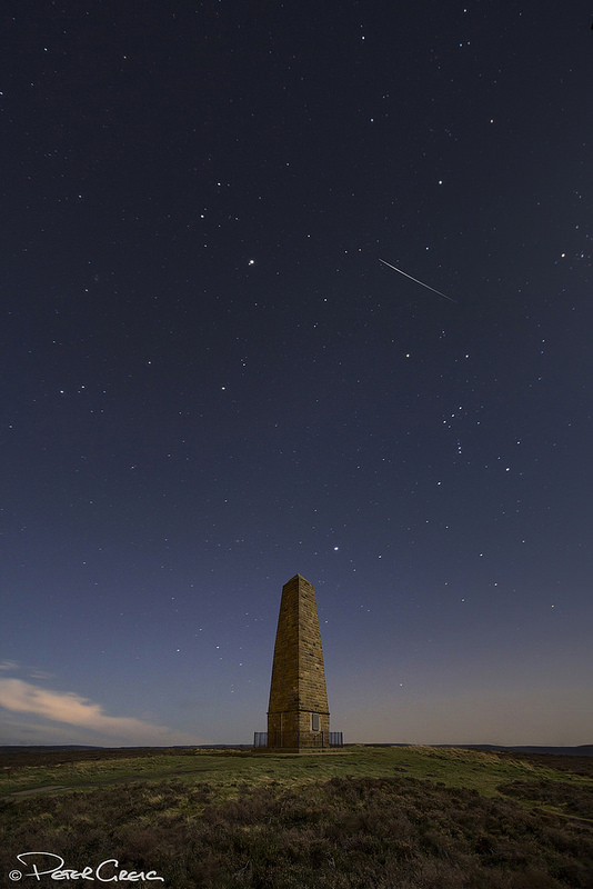 A Geminid meteor on Dec. 14, 2013 over the Captain Cook Monument in North Yorkshire, UK. Credit and copyright: Peter Greig.