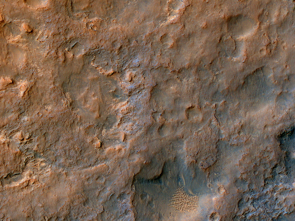 Tracks from the Curiosity rover are visible from orbit to the HiRISE camera on the Mars Reconnaissance Orbiter. Credit: NASA/JPL/University of Arizona.