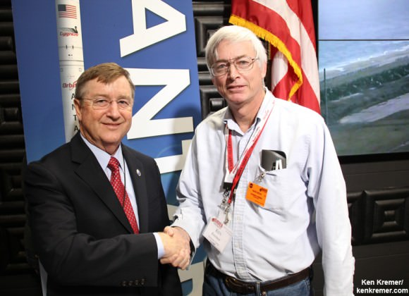 Frank Culbertson; executive vice president and general manager of Orbital's advanced spaceflight programs group and former Space Shuttle commander, and Ken Kremer; Universe Today, at NASA Wallops Flight Facility, VA, discuss extension of the International Space Station lifetime following Jan. 9 Antares/Cygnus blastoff.  Credit: Ken Kremer – kenkremer.com