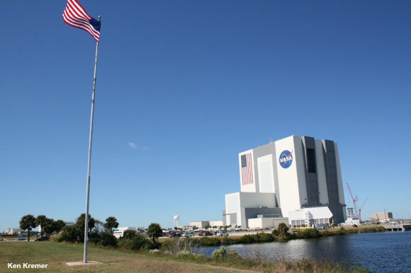 View of the Vehicle Assembly Building (VAB) and the Turn Basin adjacent to the Kennedy Space Center Press Center and the countdown clock. Credit: Ken Kremer – kenkremer.com
