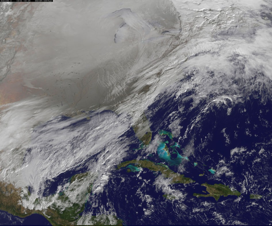 This image was captured by NOAA's GOES-East satellite on January 6, 2014 at 1601 UTC/11:01 a.m. EST. A frontal system that brought rain to the coast is draped from north to south along the U.S. East Coast. Behind the front lies the clearer skies bitter cold air associated with the Polar Vortex.