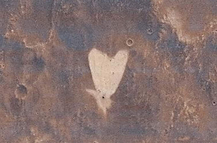 A heart-shaped feature in the Arabia Terra region of Mars taken by NASA's Mars Reconnaissance Orbiter. Image Credit: NASA/JPL-Caltech/MSSS.