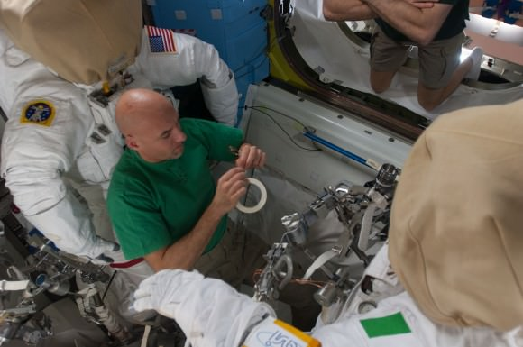 European Space Agency astronaut Luca Parmitano does spacesuit maintenance prior to July 9 and 16, 2013 spacewalks. Parmitano was a member of Expeditions 36 and 37. Credit: NASA