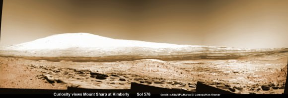 Martian landscape with rows of curved rock outcrops at 'Kimberly' in the foreground and spectacular Mount Sharp on the horizon. NASA's Curiosity Mars rover pulled into Kimberly waypoint dominated by layered rock outcrops as likely drilling site.  This colorized navcam camera photomosaic was assembled from imagery taken on Sol 576 (Mar. 20, 2014).  Credit: NASA/JPL-Caltech/Marco Di Lorenzo/Ken Kremer-kenkremer.com